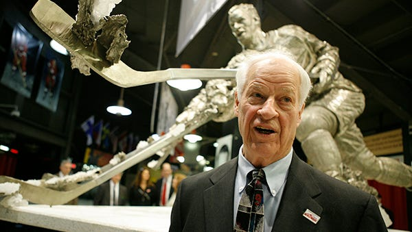 Gordie Howe is pictured at Joe Louis Arena in 2007 in front of his statue.