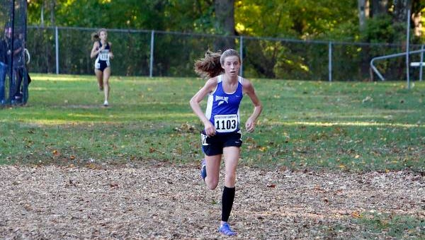 Ursuline's Anna Flynn repeated as the girls champ at the Westchester County Cross Country Championships Saturday at Woodlands High School in Hartsdale.