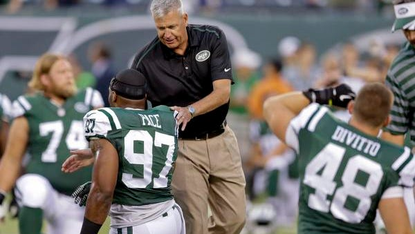 Jets coach Rex Ryan encourages linebacker Calvin Pace (97) during warmups before the preseason game against the Giants on Friday night.
