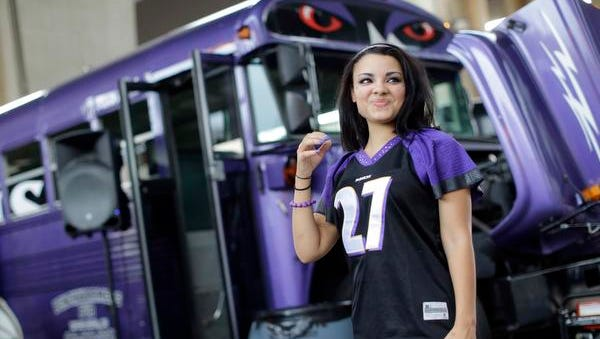 Ravens fan Racquel Bailey wears a Ray Rice jersey as she tailgates before the game in Baltimore on Thursday night.