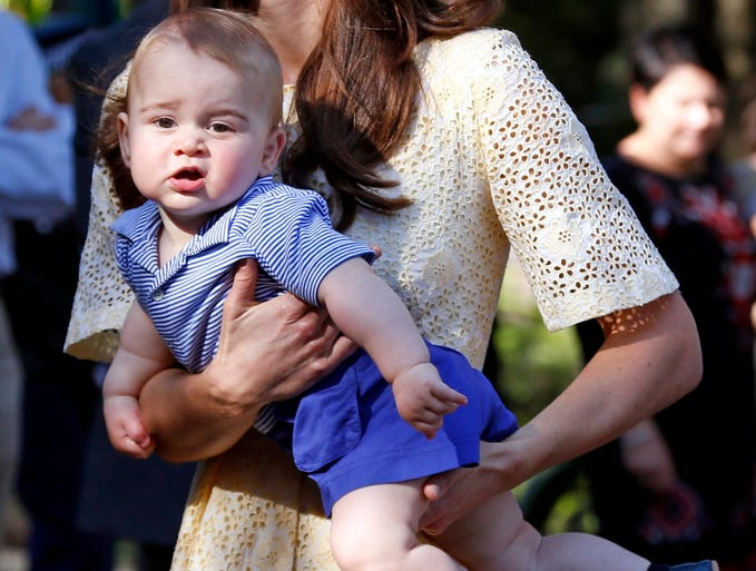 Britain's Catherine, Duchess of Cambridge, carries her son, Prince George, in the Taronga Zoo in Sydney. George is a baby, after all, and they can get fussy. Here are moments when the young royal just wasn't interested in the attention.