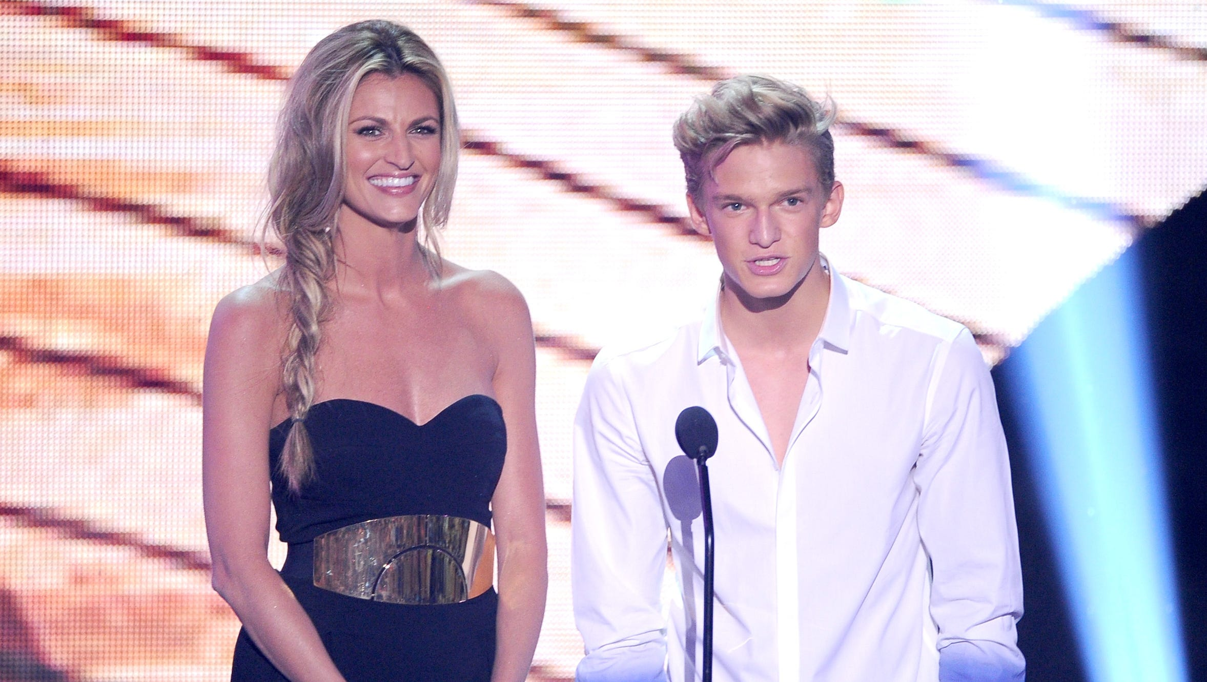 TV personality Erin Andrews and singer Cody Simpson share the stage.