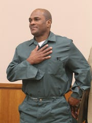Charles Pierre had his conviction overturned  for a double-murder he was accused of from 2002.  Pierre taps his chest, heart area as he silently communicates to someone after the ruling.
