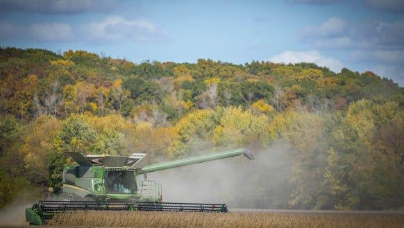 Howard Goodhue combines soybeans near Carlisle, Iowa,