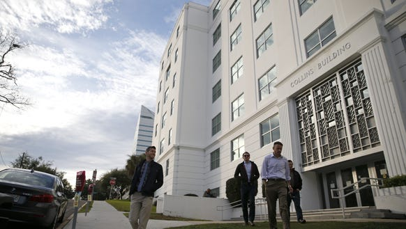 Workers leave the Collins Building, the Tallahassee office of the attorney general and department of legal affairs. The State of Florida employs more than 162,000 workers - 19,000 in Leon County.