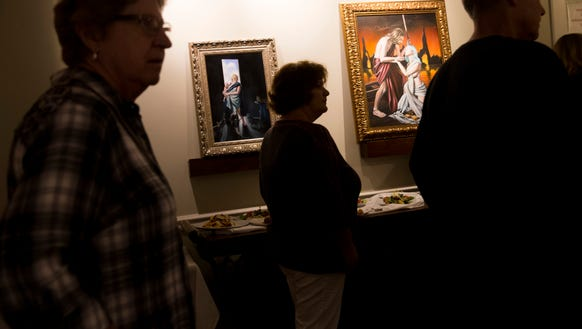 Guests pass by several commissioned pieces while touring