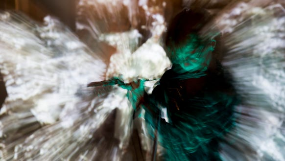 Flautist Kat Epple, in a blur of ever-changing light
