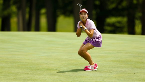 Lucy Li reacts to barely missing a putt  on the 16th