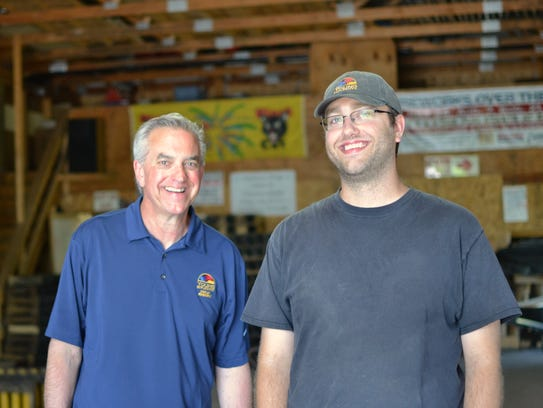 Jim Young, left, and his son Tim work side by side