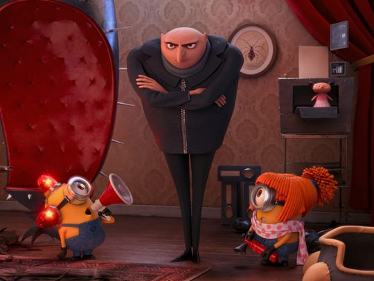 Gru as voiced by Steve Carell with the Minions.