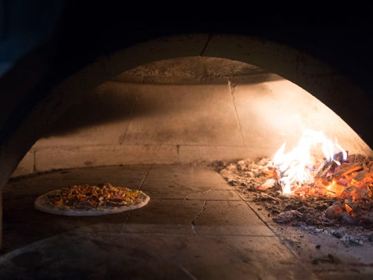 Hard Knox Pizzeria uses a brick wood-fired oven.