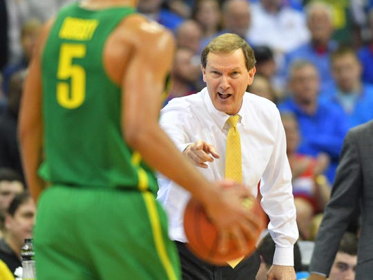 Oregon Ducks head coach Dana Altman reacts with guard Tyler Dorsey (5) during the second half against the Kansas Jayhawks in the finals of the Midwest Regional of the 2017 NCAA Tournament at Sprint Center.