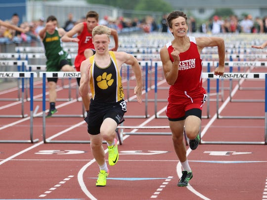 Piketon's Timothy Trawick and Paint Valley's Caden Summar compete in the 110 hurdles during the Division III district track and field finals at Southeastern High School this past spring.