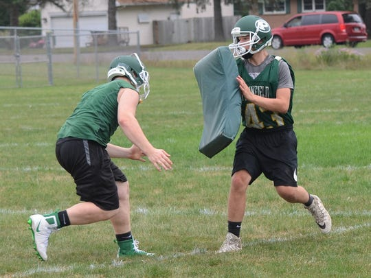 Pennfield players go through a drill during the first