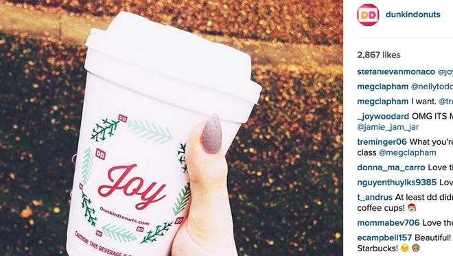 Dunkin' Donuts unveiled its seasonal coffee cup design on Tuesday.