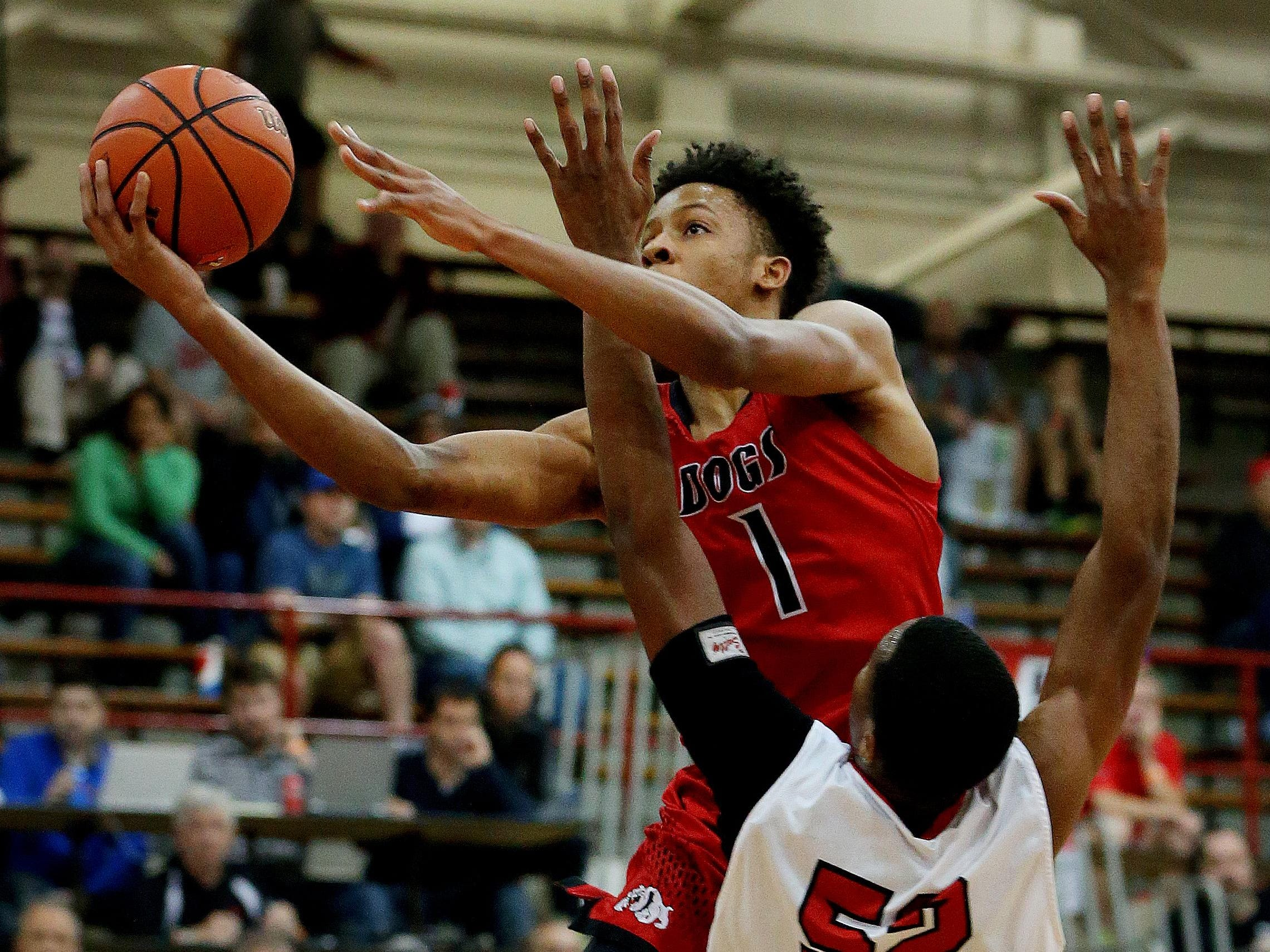 New Albany's Romeo Langford (1) goes up for the shot and is fouled by Pike's Durante Lee (52) during the Tip Off Classic on Dec. 12, 2015.