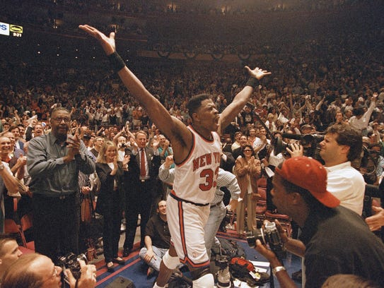 New York Knicks Patrick Ewing (33) raises his arms