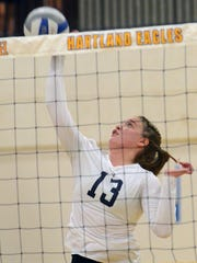 Hartland's Megan Acs spikes the ball against Brighton.