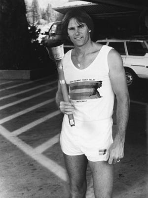 American Decathlete, Caitlyn Jenner, formerly known as Bruce Jenner, poses with the 1984 Olympic Torch she carried through Lake Tahoe, Nevada.