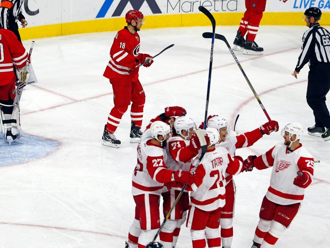 The Detroit Red Wings celebrate a goal by Teemu Pulkkinen,