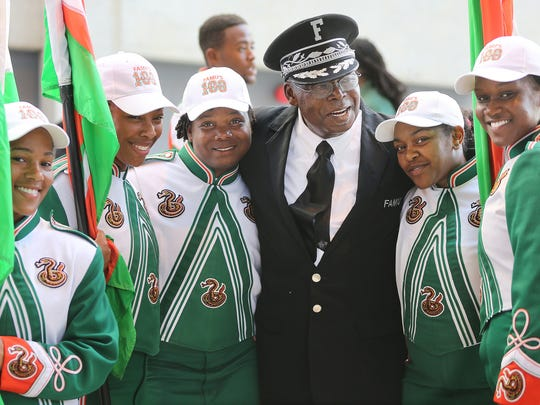 Marching 100 Director, Sylvester Young with band members.