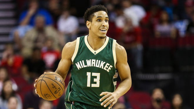 Milwaukee Bucks guard Malcolm Brogdon (13) brings the ball up the court during the first quarter against the Houston Rockets at Toyota Center.