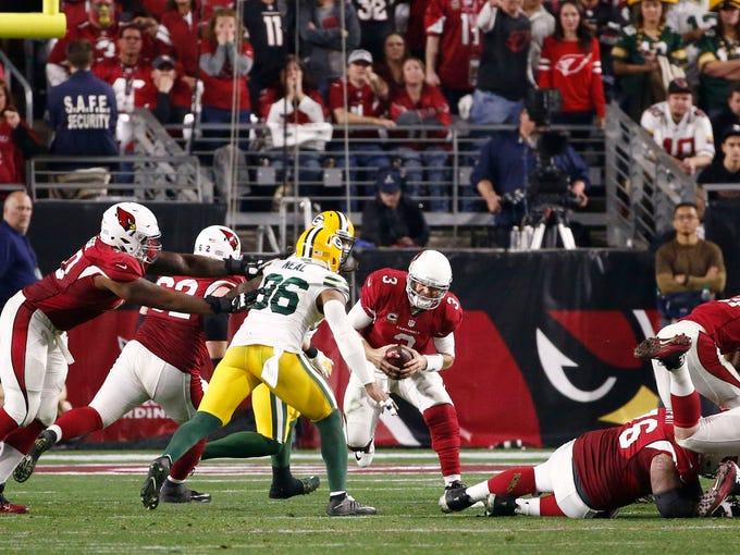Arizona Cardinals quarterback Carson Palmer spins out