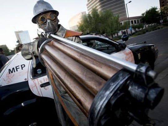 An Arizona Republic photographer captured this photo of Bryan Patrick Miller, dressed as a zombie hunter, during an October 2014 zombie walk in downtown Phoenix. Phoenix police have since arrested Miller in the grisly 1990 canal murders.