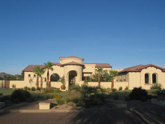 Dino and Donna Divenere paid $1.9 million for this 5,394 square-foot home at Country Club Acres in Paradise Valley. The sale closed during the week of September 28, 2015.