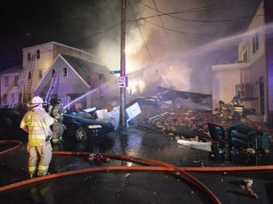 Firefighters battle the blaze set by Lamotte Scales on June 16, 2014. Even though Francine Wallace lost everything in the fire, she has forgiven Scales, who died in the fire.