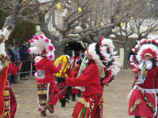 Dancers gather at Tortugas pueblo at a Our Lady of Guadalupe Festival.
