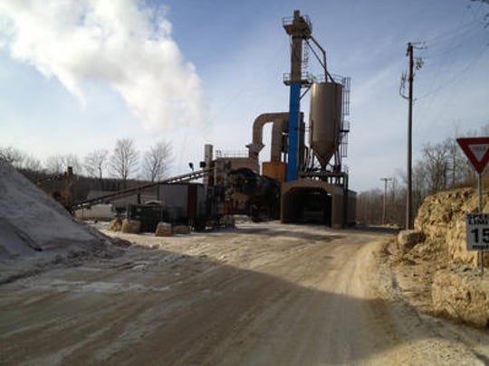 Pattison Sand Co. in Clayton sorts sand in a washing process to collect the tiny, round particles used for fracking. The material is then sent through a dryer before shipping.