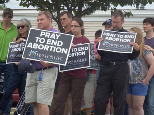 Abortion protesters picket outside the Planned Parenthood clinic in Iowa City in 2015.