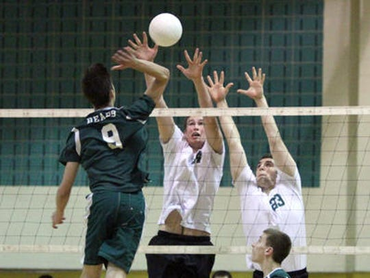 East Brunswick's Kyle Loesner (9) gets ready to hit the ball as St. Joseph defenders Bryan Carley (center) and Connor Mahony try to defend during the GMC Tournament final on May 16, 2015.