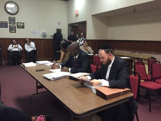 Spring Valley trustees Asher Grossman, Vilair Fonvil and Sherry McGill sit separate from the mayor and village clerk in a protest