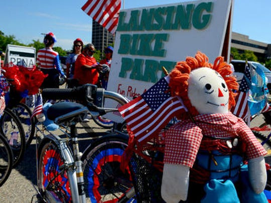 A Raggedy Andy doll makes an appearance on a Lansing Bike Party bike on Monday during the Lansing Fourth of July parade near the state Capitol in downtown Lansing.