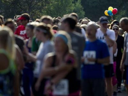 Runners start the Balloon Chase 5K Run/Walk at the
