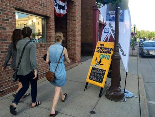 People roam the streets of downtown to score deals