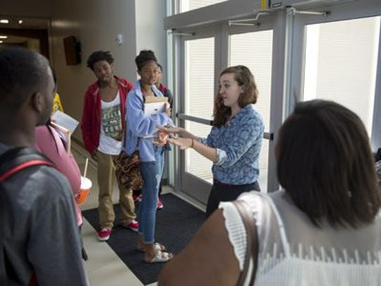 Claire Brulatour (center), regional coordinator for tnAchieves, talks with students between classes during the tnAchieves Summer Bridge program at Southwest Tennessee Community College. The program helps recent high school graduates prepare for college.