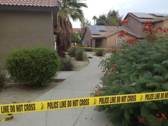 Police tape encircles a Cathedral City apartment complex