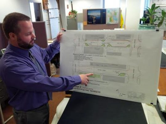 Josh Miller explains the Second Street Corridor project that was implemented in Marshfield.