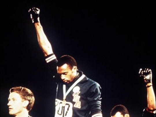 "Ralph Stokes, a Lee superstar, drew even more attention after breaking free during a road game and raising his fist as he scored.  This was just two years afterTommie Smith and John Carlos hoisting black-gloved fists on the podium after winning gold and bronze medals at the 1968 Summer Olympics in Mexico City pictured).  ""I didn't even realize I had raised my hand,"" Stokes said. ""You're just celebrating."""