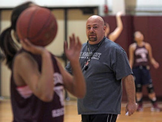 Ossining varsity girls basketball coach Dan Ricci watches his team run drills during practice at Ossining High School in 2012. Ricci is one of four Section 1 coaches who will be inducted in the New York State Basketball Hall of Fame on March 26, 2017.
