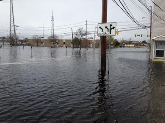 Flooding in downtown Toms River near Toms River Fire Co. 2, on Oct. 30, 2012, the day after superstorm Sandy. The fire department building can be seen on the right.