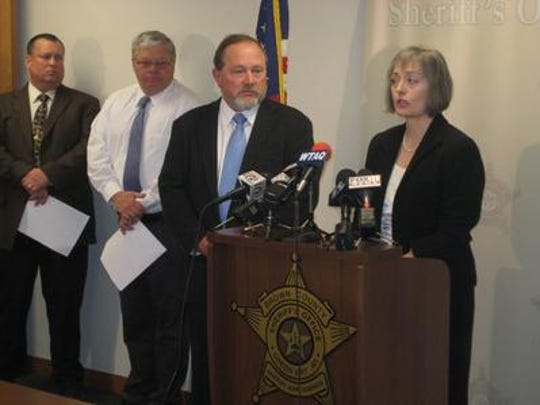 Paula Schultz, right, asks people with information about the death of her son, Doug McMillin, 19, to come forward. McMillin was shot and killed at his Allouez home during a possible drug-related robbery attempt on March 8, 2009. Schultz is joined by her husband, Fred, and Brown County Sheriff's Sgt. Al Phillips.