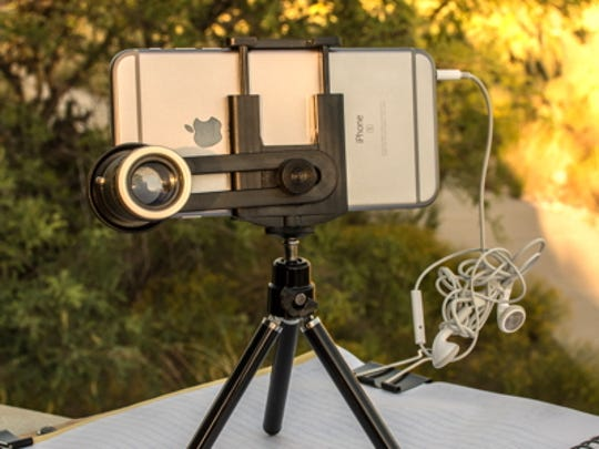 Photo of Mike Weasner's iPhone attached with a clip-on telephoto lens.