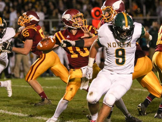 Voorhees quarterback George Eberle passes from the