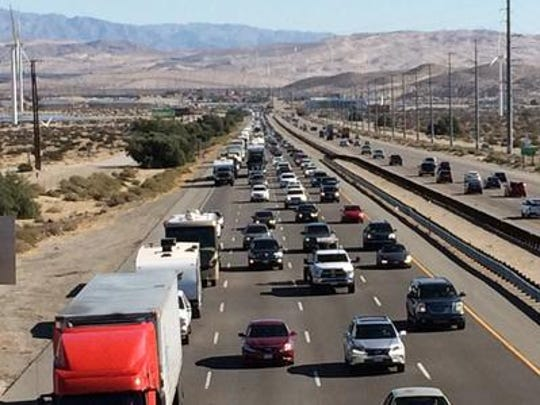 This Desert Sun file photo shows travelers heading home after Thanksgiving. The Automobile Club of Southern California predicts 4.3 million Southern Californians will travel this year. Traffic expected to be heaviest beginning Tuesday, Nov. 26, 2019.