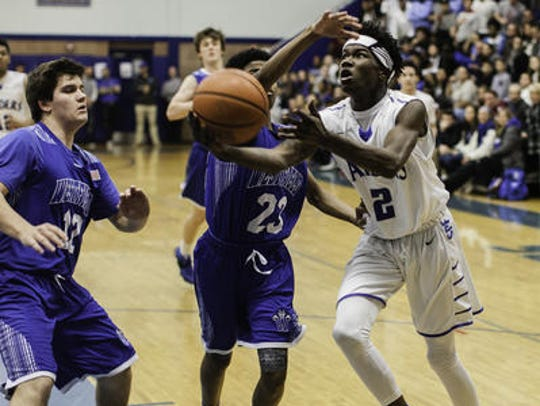 Westfield's Marshall Roberson defends against Scotch