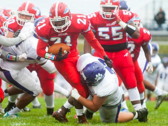 Martin Booker Jr. carries the ball for Pennsauken High School at a home game in September 2016. Voters on Tuesday approved plans for a new turf field as part of a $35.6 million improvement package.